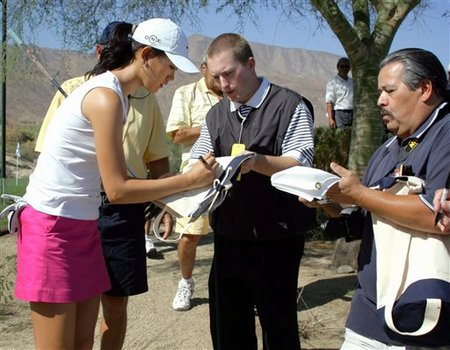 Michelle Wie signs autograph for fans