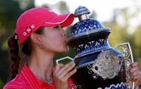 Michelle Wie gets first LPGA Tour win at Lorena Ochoa Invitational_kissing her trophy.PNG