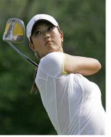 Michelle Wie looking up after finishing her swing.PNG