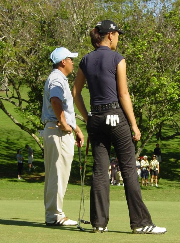 Michelle Wie at the 2002 Hawaii Amateur stroke-play champ Joe Phengsavath