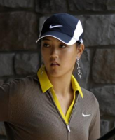 Michelle Wie hot picture with white and dark blue cap.PNG