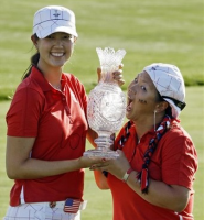 Michelle Wie and Christina Kim holding a trophy for the Team USA Solheim Cup.PNG