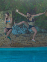 Michelle Wie and Christina Kim jump into the pool.PNG